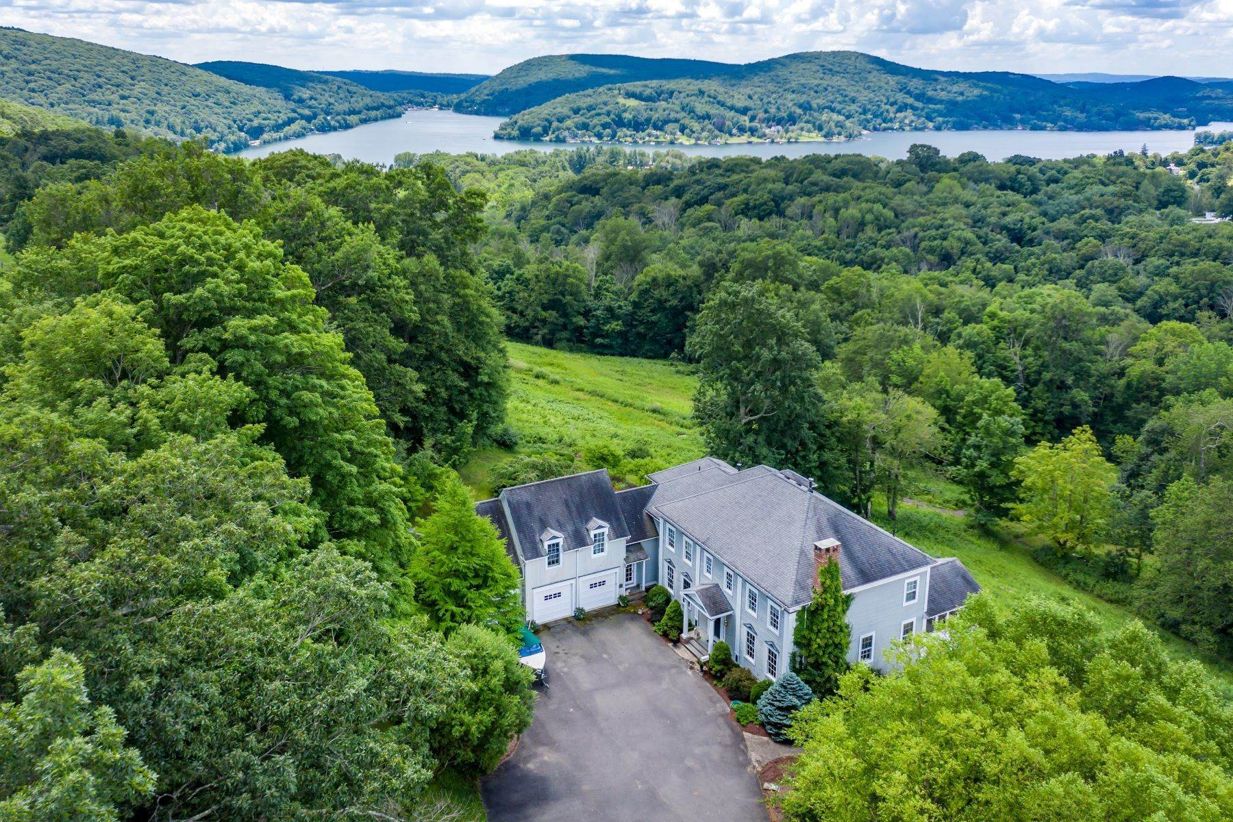 Single Family Homes for Sale at Vast Lake Waramaug Views 293 Lake Road Warren, Connecticut 06777 United States